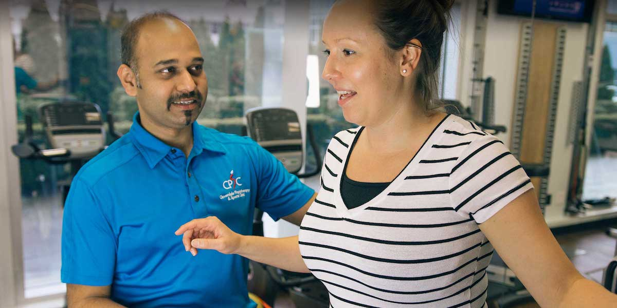 Working on a Back Pain Injuries With Physiotherapist in Surrey, BC   Surrey 152St Nordel Physiotherapy & Sports Injury Clinic